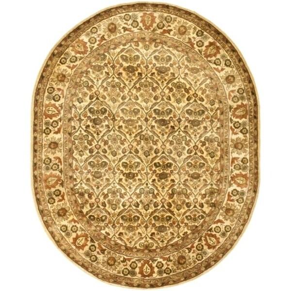 "Safavieh Handmade Treasured Gold Wool Rug - 7'-6"" x 9'-6"" oval"