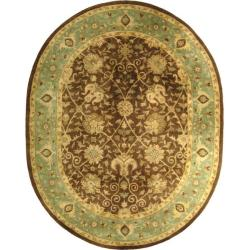 Safavieh Handmade Mashad Brown/ Green Wool Rug (4'6 x 6'6 Oval)