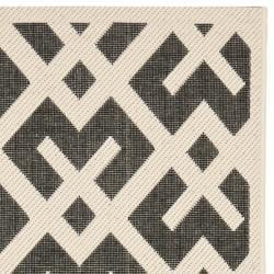 Safavieh Courtyard Contemporary Black/ Bone Indoor/ Outdoor Rug (2'4 x 9'11) - Thumbnail 1
