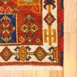 Indo Hand-knotted Kazak Rust/ Light Brown Wool Rug (2' x 4') - Thumbnail 1