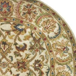 Safavieh Handmade Classic Ivory Wool Rug (7'6 x 9'6 Oval) - Thumbnail 1