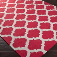 Hand-woven Red Caroni Wool Area Rug - 5' x 8'