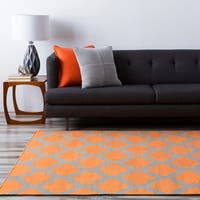 Hand-woven Orange Caroni Wool Area Rug - 5' x 8'