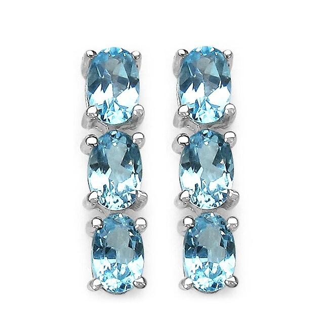 Malaika Sterling Silver 3 7/8ct TGW Oval-cut Blue Topaz Earrings