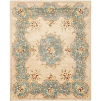 Safavieh Handmade Ivory/ Light Blue Hand-spun Wool Rug - 9' x 12'