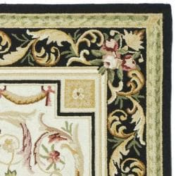 Safavieh Hand-hooked Aubusson Ivory/ Black Wool Rug (6' x 9') - Thumbnail 1