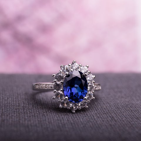 Miadora Sterling Silver Sapphire and Diamond Accent Halo Engagement Ring