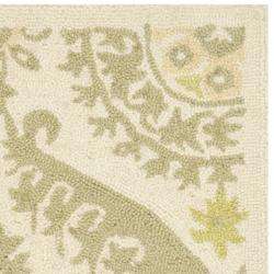 Safavieh Hand-hooked Chelsea Heritage Beige Wool Rug (1'8 x 2'6) - Thumbnail 1