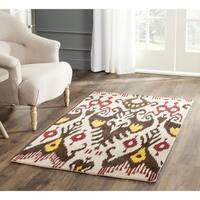 Safavieh Handmade Ikat Beige/ Brown Wool Rug - 4' x 6'
