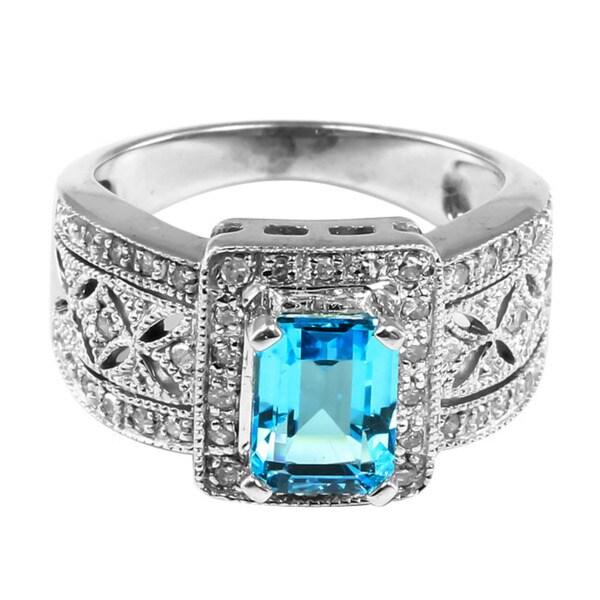 10k Gold Emerald-cut Blue Topaz and 1/4ct TDW Diamond Ring (H-I, I1-I2)