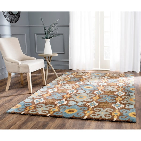 Safavieh Handmade Festive Brown New Zealand Wool Rug - 7'6 x 9'6
