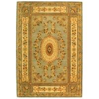 Safavieh Handmade Oasis Light Blue/ Ivory Hand-spun Wool Rug - 9' x 12'