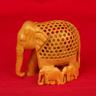 Hand-carved Kadam Wood Jali Elephant with Family Figurine (India)