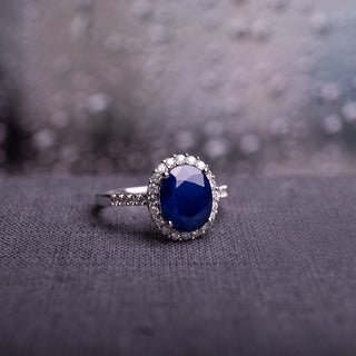 14k White Gold Oval-Cut Diffused Sapphire and 2/5ct TDW Diamond Halo Engagement Ringby The Miadora S