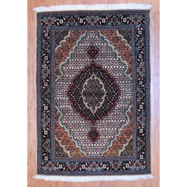 Persian Hand-knotted Tribal Tabriz Ivory/ Black Wool Rug (3'3 x 5')