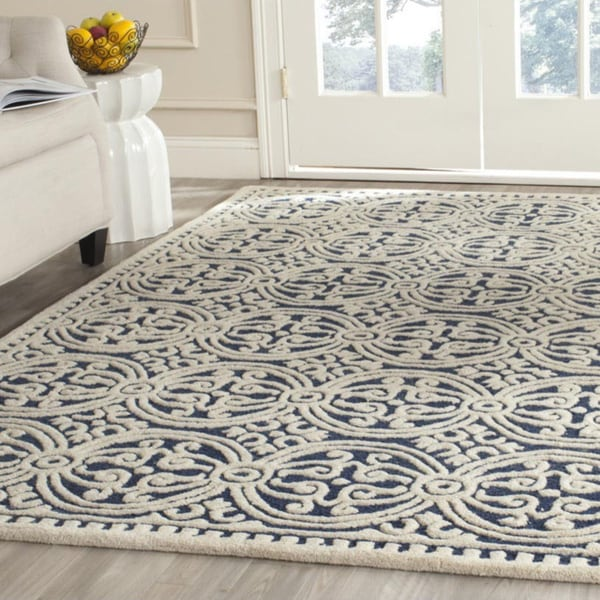 Safavieh handmade moroccan cambridge navy blue wool rug for Dining room rugs 9x12
