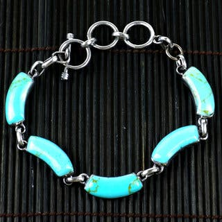Handmade Mexican Alpaca Silver and Turquoise Curve Bracelet (Mexico) https://ak1.ostkcdn.com/images/products/7539161/7539161/Handcrafted-Mexican-Alpaca-Silver-and-Turquoise-Curve-Bracelet-Mexico-P14974230.jpeg?impolicy=medium