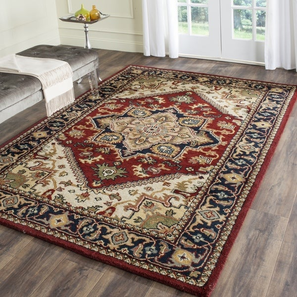 Safavieh handmade heritage traditional heriz red navy for Red and navy rug