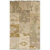 Hand-knotted Tanaina Green Wool Area Rug - 5' x 8'
