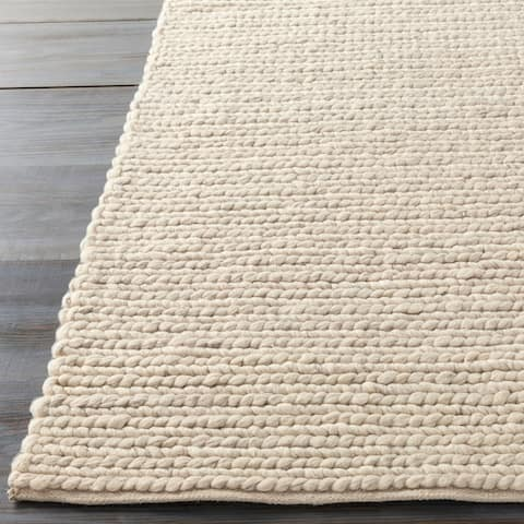 Hand-woven Butte Solid Casual Ivory Wool Area Rug - 5' x 8'