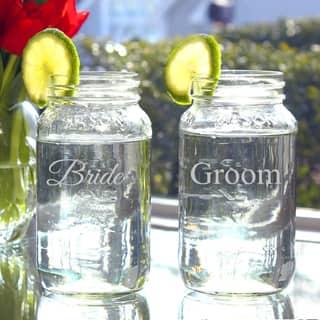Bride and Groom 26-oz Mason Jars (Set of 2)|https://ak1.ostkcdn.com/images/products/7660223/7660223/Bride-and-Groom-26-oz-Mason-Jars-Set-of-2-P15073809.jpeg?impolicy=medium