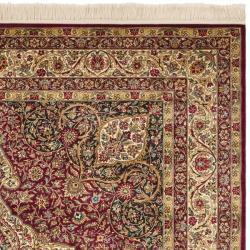 Asian Hand-knotted Royal Kerman Red/ Ivory Wool Rug (6' x 9') - Thumbnail 1