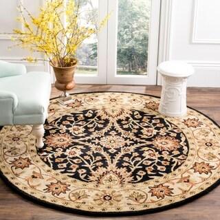 Safavieh Handmade Kerman Black/ Ivory Gold Wool Rug (6' Round)