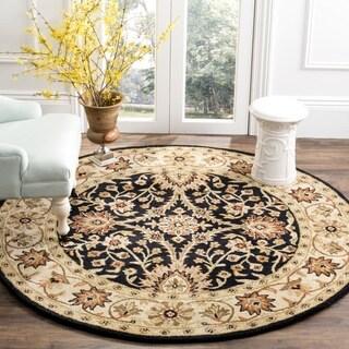 Safavieh Handmade Kerman Black/ Ivory Gold Wool Rug (8' Round)
