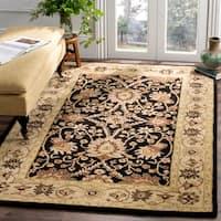 Safavieh Handmade Kerman Black/ Ivory Gold Wool Rug - 6' x 9'