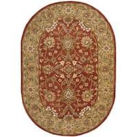Safavieh Handmade Kerman Rust/ Gold Wool Rug - 7'6' x 9'6' oval