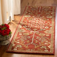 Safavieh Handmade Heritage Timeless Traditional Red Wool Rug - 2'3 x 10'