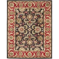 Safavieh Handmade Heritage Timeless Traditional Chocolate Brown/ Red Wool Rug - 6' x 9'