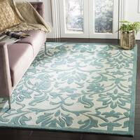 Safavieh Handmade Modern Art Floral Scrolls Ivory/ Light Blue Polyester Rug - 8' x 10'