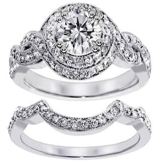 14k White Gold 2ct TDW Clarity Enhanced Diamond Halo Bridal Ring Set https://ak1.ostkcdn.com/images/products/7846112/14k-White-Gold-2ct-TDW-Clarity-Enhanced-Diamond-Halo-Bridal-Ring-Set-F-G-SI1-SI2-P15233493.jpg?impolicy=medium