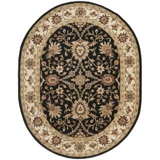 Safavieh Handmade Kerman Black/ Ivory Gold Wool Rug (4'6 x 6'6 Oval)