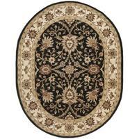 Safavieh Handmade Kerman Black/ Ivory Gold Wool Rug - 4'6' x 6'6 oval