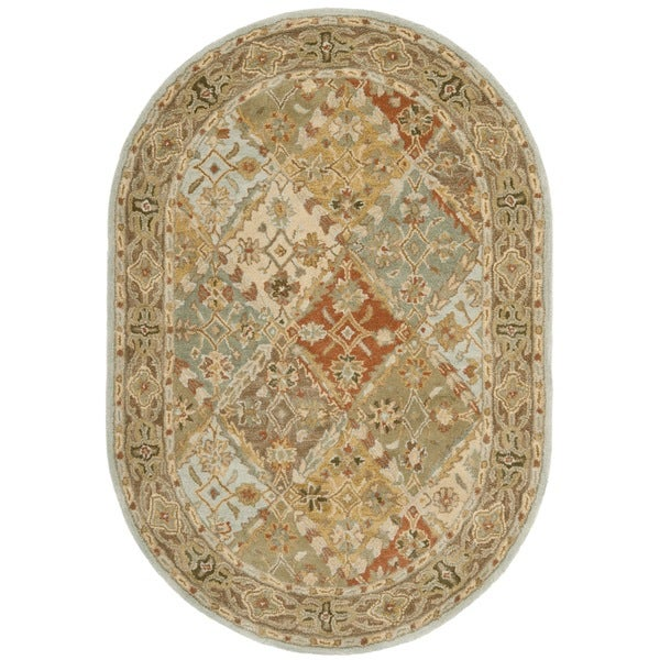 Safavieh Handmade Heritage Traditional Bakhtiari Light Blue/ Light Brown Wool Rug - 4'6 x 6'6 Oval