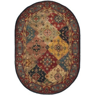 Safavieh Handmade Heritage Timeless Traditional Red Wool Rug (4'6 x 6'6 Oval)
