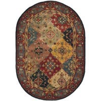 Safavieh Handmade Heritage Timeless Traditional Red Wool Rug - 4'6' x 6'6 oval