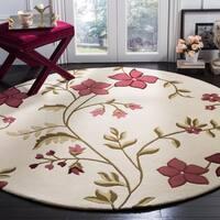 Safavieh Handmade Capri Ivory/ Purple Wool Rug - 7' Round