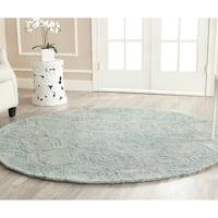 Safavieh Handmade Ikat Ivory/ Sea Blue Wool Rug - 6' Round