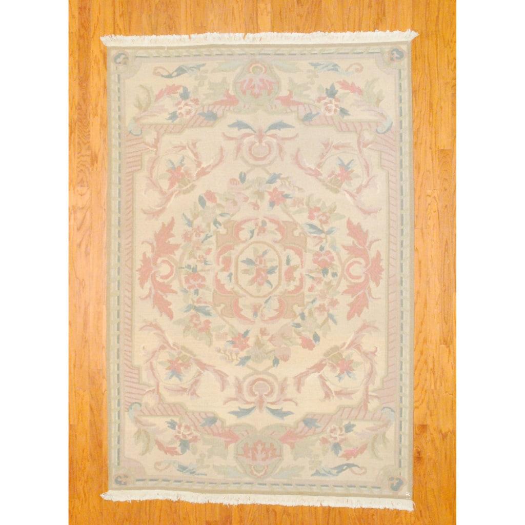 Indo Hand-knotted Kilim Beige/ Peach Wool Rug (6' x 8'10)