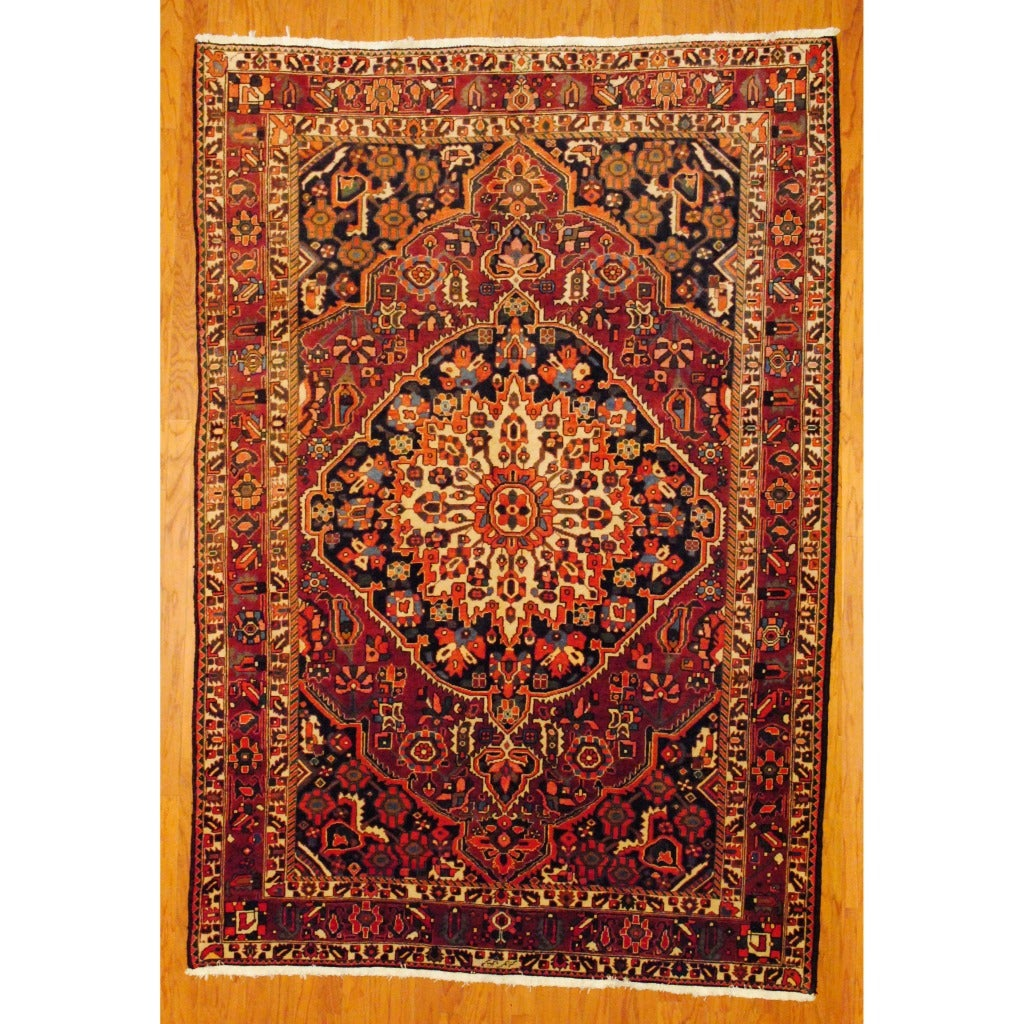 Persian Hand-knotted Bakhtiari Rust/ Navy Wool Rug (6'6 x 9'10)