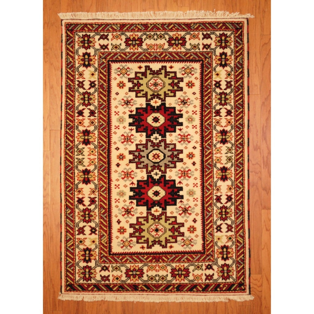 Indo Hand-knotted Kazak Ivory/ Rust Wool Rug (4' x 6')