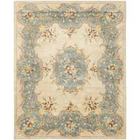 Safavieh Handmade Ivory/ Light Blue Hand-spun Wool Rug - 9'6 x 13'6