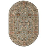 Safavieh Handmade Heritage Timeless Traditional Blue Wool Rug - 5' x 8' Oval