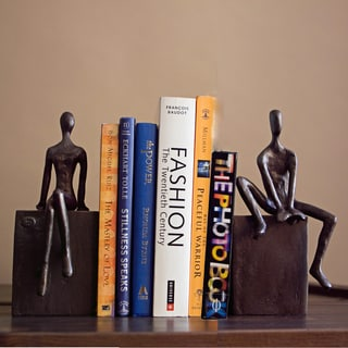 Man and Woman Sitting on a Block Metal Bookend Set