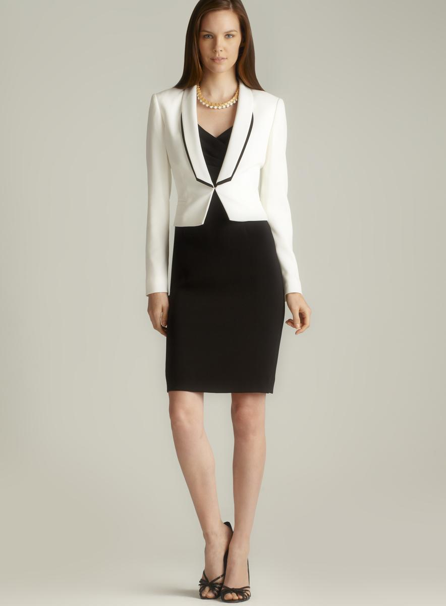 Colorblock Suit Set Black Suits 16W *Contrasting colors and princess seams add dimension and charm to the traditional suit set *Sleeveless sheath dress has a back zipper *Fully lined *Approx. Browse Tahari Suits .
