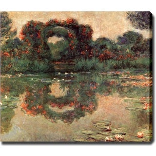 Claude Monet 'Water Lily Pond' Canvas Art