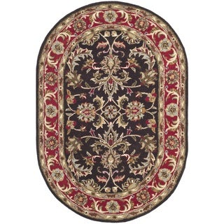 Safavieh Handmade Heritage Timeless Traditional Chocolate Brown/ Red Wool Rug (7'6 x 9'6 Oval)